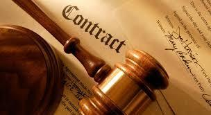 a gavel laying on a contract